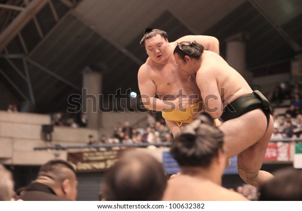 TOKYO - APRIL 7: Popular sumo wrestlers Hakuho and Bakuto in during a tournament in Tokyo, Japan on April 7, 2012. While the sport is mostly dominated by foreigners it is still Japan's national sport.