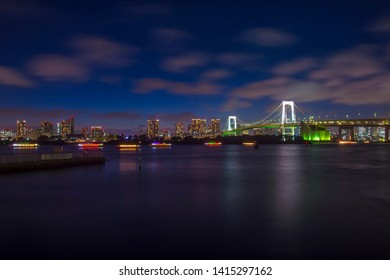 TOKYO - AUG 21 : Night view of Rainbow bridge in Tokyo Japan on August 21 2018. The bridge crossing Tokyo Bay between Shibaura Pier and Odaiba.