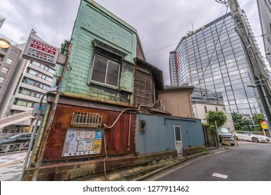 Tokyo - August 16, 2018 : Old car repair shop in Takanawa district near Shinagawa JR Station