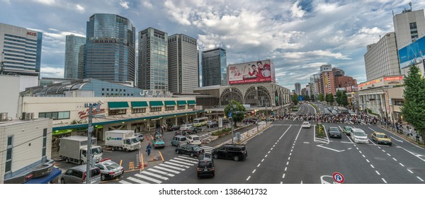 Tokyo - August 16, 2018 : Panoramic view of Rush Hour crowd crossing street in front of Japan Railways JR Shinagawa station, Ota Ward.