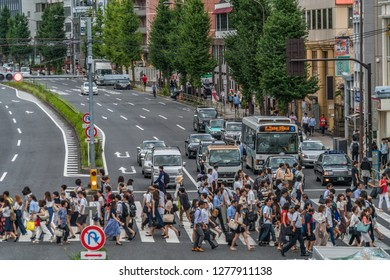 Tokyo - August 16, 2018 : Rush Hour crowd crossing street in front of Shinagawa station, Ota Ward.