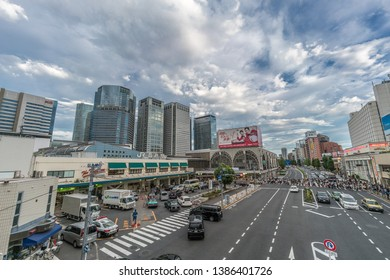 Tokyo - August 16, 2018 : Rush Hour crowd crossing street in front of Japan Railways JR Shinagawa station, Ota Ward.