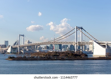 Tokyo Bay with Rainbow Bridge in Odaiba city skyline, Japan.