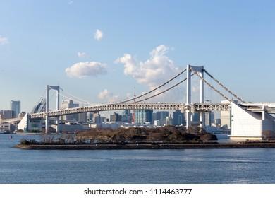 Tokyo Bay with Rainbow Bridge in Odaiba city skyline, Japan.