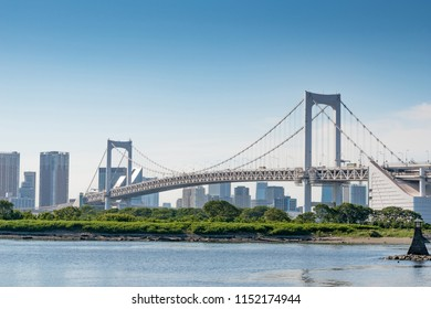 Tokyo Bay with Rainbow Bridge in Odaiba city skyline, Japan