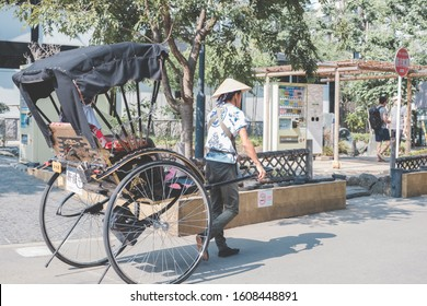 Tokyo City, Japan-01/08/2020: A rickshaw originally denoted a two or three-wheeled passenger cart, now known as a pulled rickshaw, which is generally pulled by one man carrying one passenger.