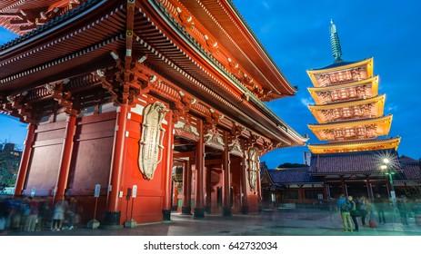 Tokyo City Night View Popular Landmark Panorama, Red Kaminarimon Gate (Hozomon Main Gate Building) and 5 Stories Buddhist Pagoda Sensoji Temple Shrine full of tourists under blue sky, Asakusa, Japan