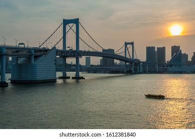 Tokyo city and Rainbow bridge at sunset