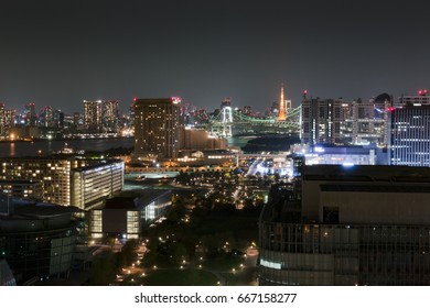 Tokyo city skyline in the night. View from Odaiba with Tokyo tower in distance