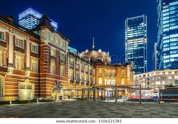 Tokyo city skyline at railway station surround by modern highrise building at twilight time.  Tokyo city, Japan.