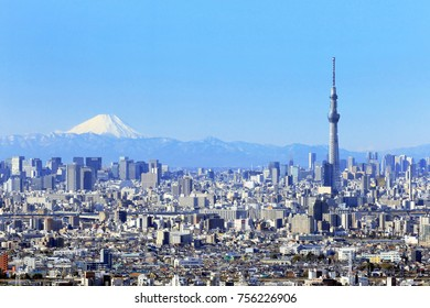 Tokyo city view , Tokyo sky tree with Tokyo downtown building and Winter Mountain fuji in background