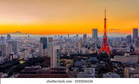 Tokyo city view with Tokyo Tower and mt. Fuji visible on the horizon at sunset time. Tokyo is both the capital and largest city of Japan.