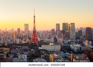 Tokyo city view with Tokyo Tower visible on the horizon at sunset time. Tokyo is both the capital and largest city of Japan.
