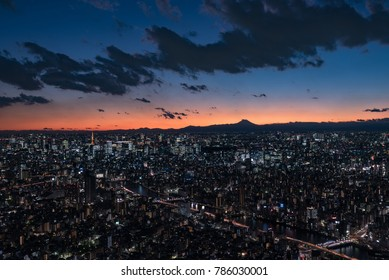 Tokyo Cityscape at dusk with Mount Fuji silhouette