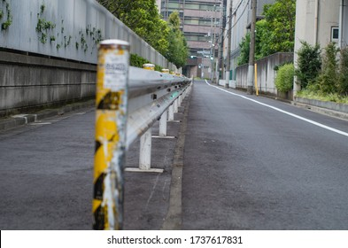 Tokyo cityscape, Public road and private road across the guardrail
