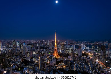 Tokyo cityscape with Tokyo tower and moon at night