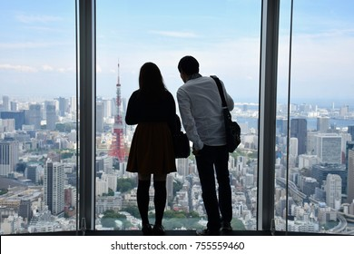 Tokyo couple lover with cityscape with Tokyo tower viewings  from roof top of the roppongi hill tower, Tokyo