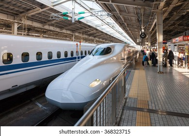 "TOKYO - FEB 5: the N700A Series bullet train at Tokyo station on Feb 5 , 2013 in Tokyo. N700A Series service as ""Nozomi (Hope)"" for Tokaido  Shinkansen line (Tokyo - Hakata route)."
