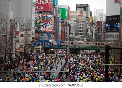 TOKYO - FEBRUARY 26: Unidentified runners participating in Tokyo Marathon on February 26, 2012 in Tokyo, Japan. With more than 36,000 athletes annually, the event is one of the biggest in Japan.