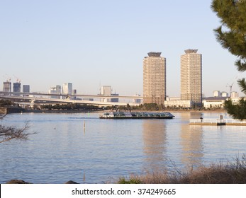 Tokyo - February 3, 2015: A view of the beautiful Tokyo Bay in the evening and people and tourists are sailing on a sea voyage on a passenger boat February 3, 2015, Tokyo, Japan