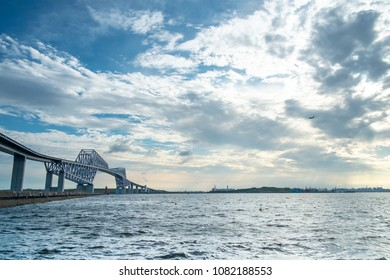 Tokyo gate bridge with sea and blue sky. Tokyo gate bridge is a truss cantilever bridge across Tokyo Bay in Tokyo, Japan