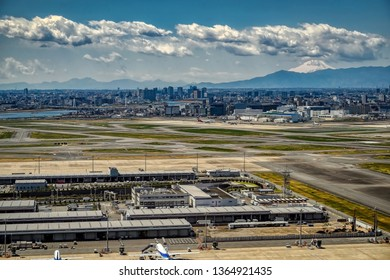 TOKYO, HANEDA AIRPORT/JAPAN - APRIL 9, 2019: All Nippon Airlines aircraft seen from the air, parked at Tokyo's Haneda Airport with Mount Fuji in the background, on April 9, 2019