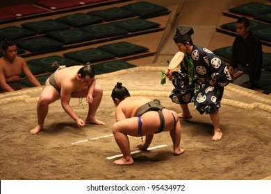 TOKYO - JANUARY 14: Unidentified wrestlers in the Grand Sumo Tournament in Tokyo, Japan on January 14, 2012. Although baseball has surpassed sumo in viewers, it is still Japan's national sport