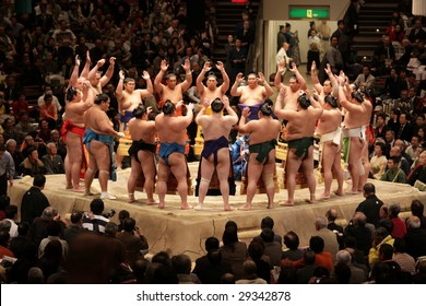 TOKYO - JANUARY 21: Sumo wrestlers perform a traditional cheer in the Tokyo Grand Sumo Tournament January 21, 2009 in Tokyo, Japan.