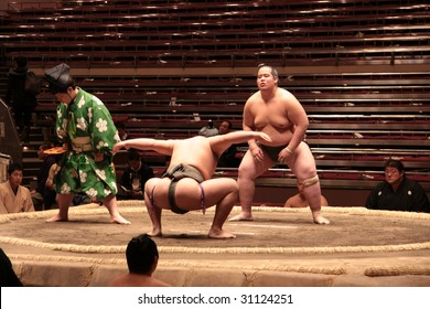 TOKYO - JANUARY 21: Sumo wrestlers flex their muscles before a fight in the Tokyo Grand Sumo Tournament January 21, 2009 in Tokyo, Japan.