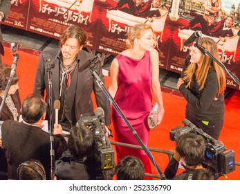 "Tokyo - January 27, 2015: Johnny Depp gives interviews and Amber Heard at the presentation of the movie ""Mordecai"" and movie posters around January 27, 2015, Tokyo, Japan"