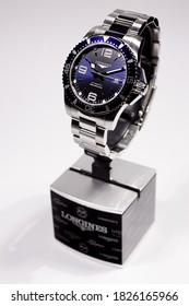 Tokyo, Japan 01.10.2020 - Longines men's wrist watch on brand stand isolated. Date function indicating 20. Famous Swiss watchmaker. classic luxury brand men's accessory. 30 bar water resistant