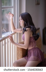 Tokyo, Japan, 02/14/2019 : Beautiful asian girl poses with sexy dress in home at morning