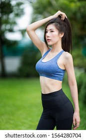 Tokyo, Japan, 02/14/2019 : Beautiful asian girl poses with sexy sportwear in park outdoor at morning