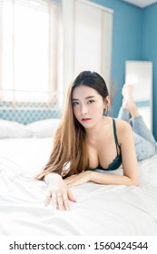 Tokyo, Japan, 02/14/2019 : Beautiful women shows slim body with sexy bra in bedroom at morning