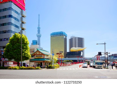 """Tokyo, Japan, 04/20/2017, Asakusa District. The building of the brewing company """"Asahi"""". TV tower """"Tokyo sky tree"""". Asakusa's attractions include the Sky Tree TV tower and Asahi Beer Hall."""
