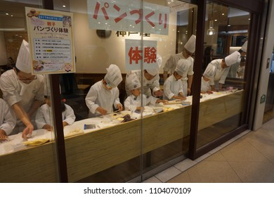 tokyo, japan, 05 07 2017 : children learning bread making in the store of ebisu