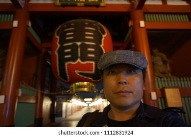 tokyo, japan, 05 07 2017 : a man standing in front of entrance of kaminarimon meaning thunder gate at asakusa