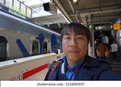 tokyo, japan, 05 08 2017 : a man standing in front of stopped train at daikanyama tokyo metro station