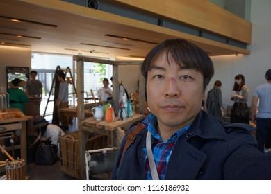 tokyo, japan, 05 08 2017 : a man standing at garden gallery antique market in hillside terrace area of daikanyama
