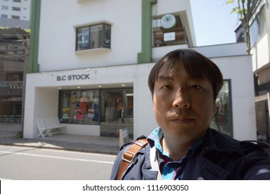 tokyo, japan, 05 08 2017 : a man standing in front of boutique shop at hillside terrace area in daikanyama