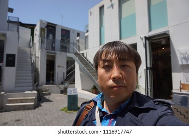 tokyo, japan, 05 08 2017 : a man standing in front of architecture of hillside terrace at daikanyama