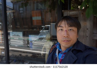 tokyo, japan, 05 08 2017 : a man standing in front of vintage gallery at hillside terrace area in daikanyama