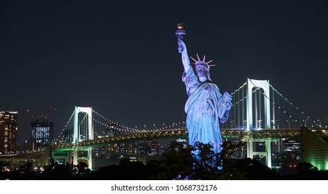 Tokyo, Japan 08.29.2017: nignt city view at the Rainbow Bridge and Odaiba Statue of Liberty on Odaiba island
