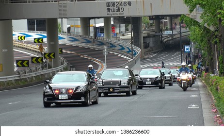 TOKYO,  JAPAN - 1 MAY 2019 : Japan's new Emperor Naruhito and new Empress Masako on the vehicle near the Imperial Palace in Tokyo. First day of Reiwa era.