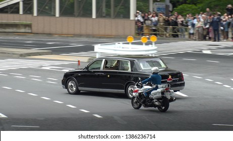 TOKYO,  JAPAN - 1 MAY 2019 : Japan's new Emperor Naruhito on the vehicle near the Imperial Palace in Tokyo. First day of Reiwa era.