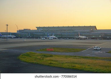 TOKYO, JAPAN -1 NOV 2017- Sunset view of the Tokyo International Airport, commonly known as Haneda Kuko (HND), a hub for Japan Airlines JAL (JL) and ANA (NH).