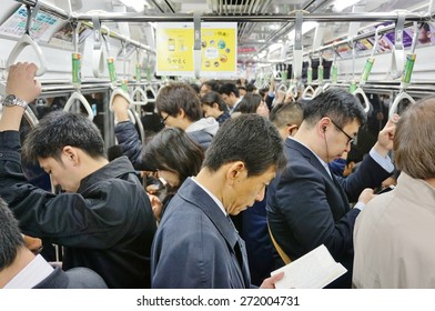 TOKYO, JAPAN -10 APRIL 2015- Commuters are packed inside a car in the Tokyo metro subway. The greater Tokyo metropolitan area has an extensive public transit system.
