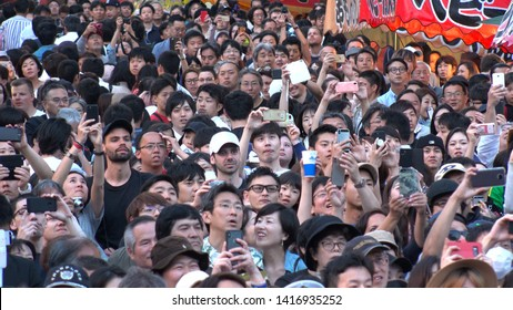 TOKYO,  JAPAN - 11 MAY 2019 : Crowd of people taking photo and video with smartphone and camera at KANDA FESTIVAL.