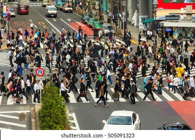 TOKYO, JAPAN - 12 OCTOBER 2016 - Many unidentified Japanese pedestrians cross the road at the busiest crosswalk in front of Shibuya station, Tokyo, Japan.