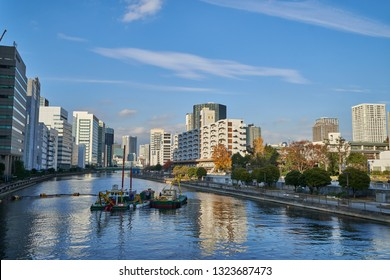 Tokyo, Japan - 12/8/2018: Boats on a tranquil channel in Shinagawa coastline district of Tokyo